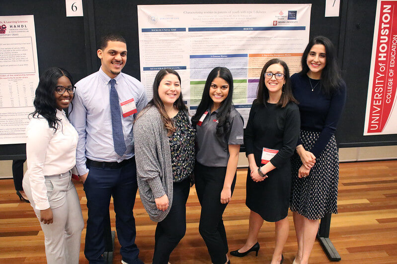 University of Houston/MD Anderson Cancer Center (UHAND) program mentees presenting their research during the student poster session.