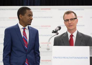 Dan O'Connor and Ezemenari Obasi speaking at United Health Foundation grant announcement event