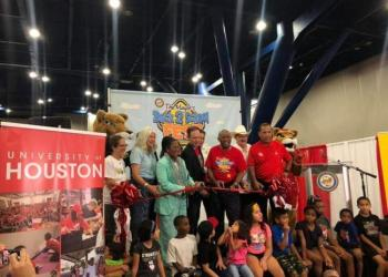 Houston Mayor and community leaders with local children